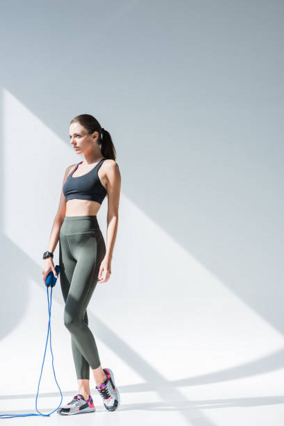 athletic girl with skipping rope stock photo