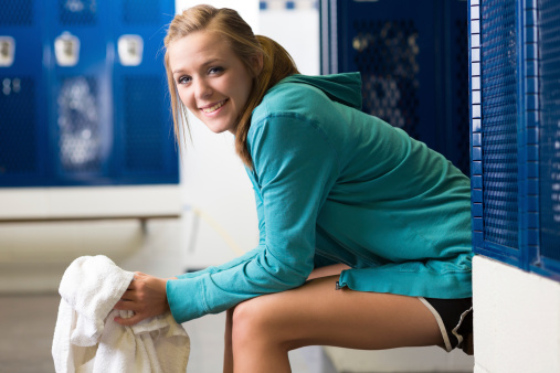 Athletic High School Girl Sitting On Bench In Locker Room Stock Photo Download Image Now Istock