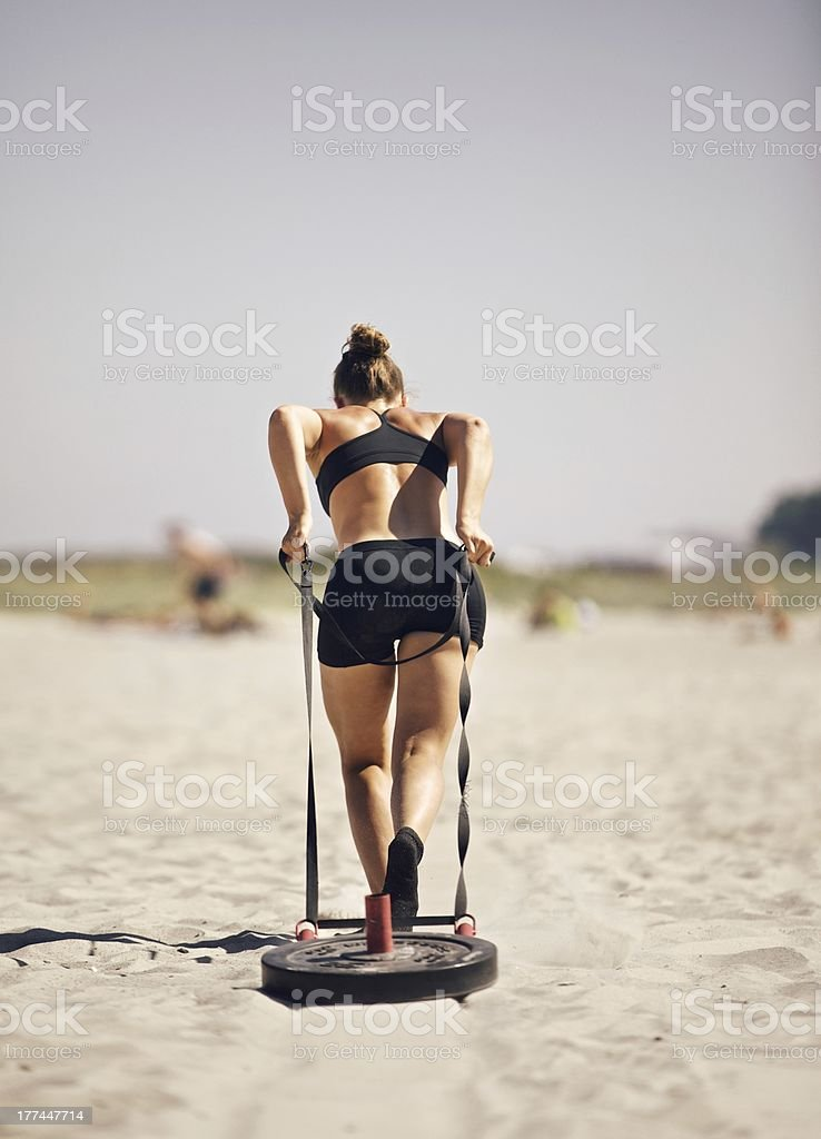 Athletic lady working out on a beach stock photo