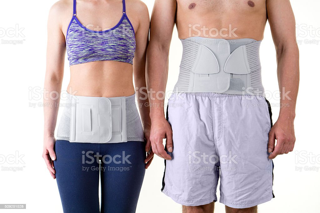 Athletic Man and Woman Wearing Back Support Braces. stock photo