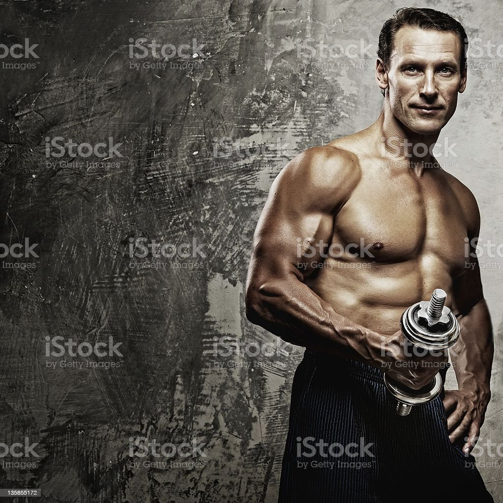 Athletic man and woman with a dummbells stock photo