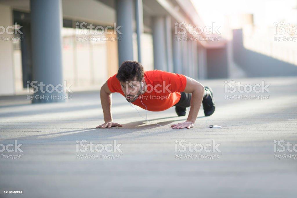 Athletic man doing push ups stock photo