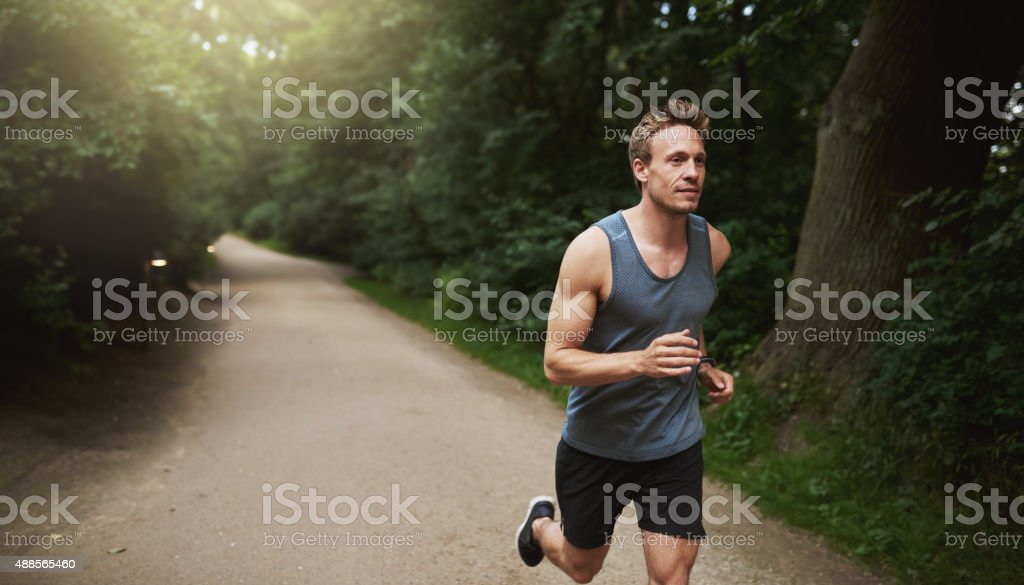 Athletic Man Doing Running Exercise at the Park stock photo