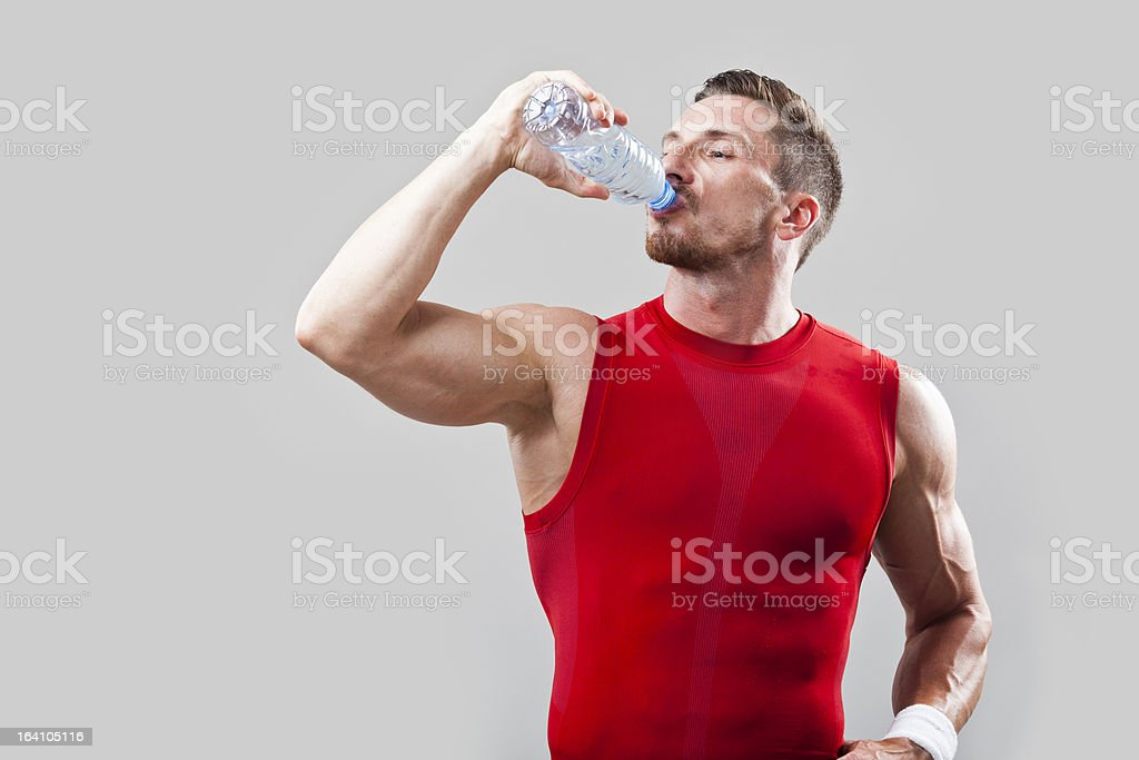 Athletic man drinking water royalty-free stock photo