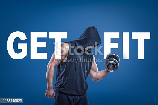 Athletic man in sleeveless hoody posing half-turn with dumbell in one hand on blue background with title GET FIT. Work out every day. Weight-lifting is power. Keep fit.