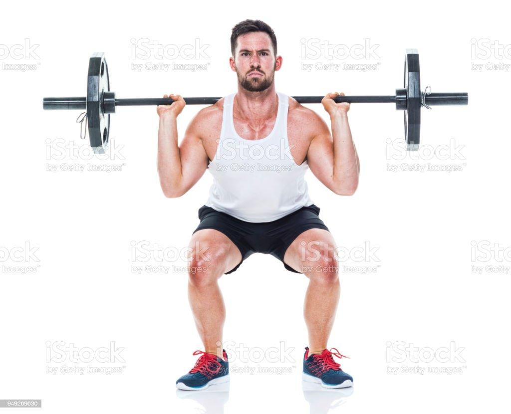 Hombre atlético elevación barra para pesas foto de stock libre de derechos