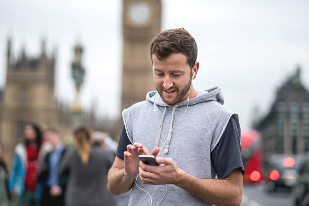 Athletic man listening to music on his cell phone stock photo