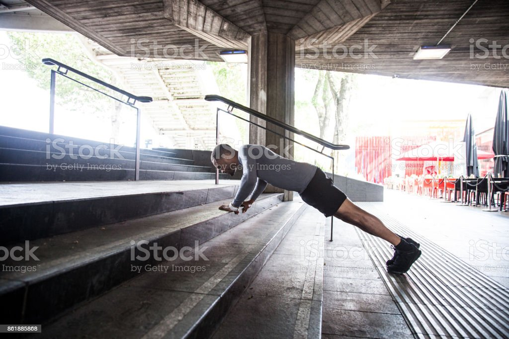 Athletic man running and getting fit in London stock photo
