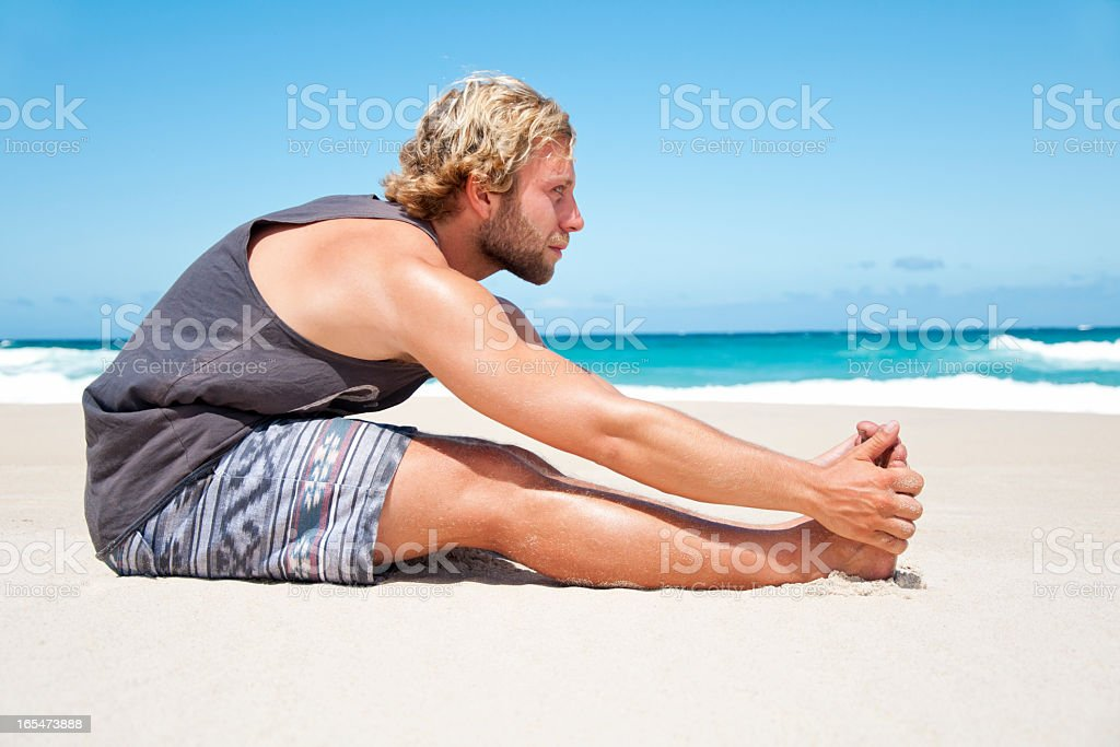 Athletic Man Stretches royalty-free stock photo
