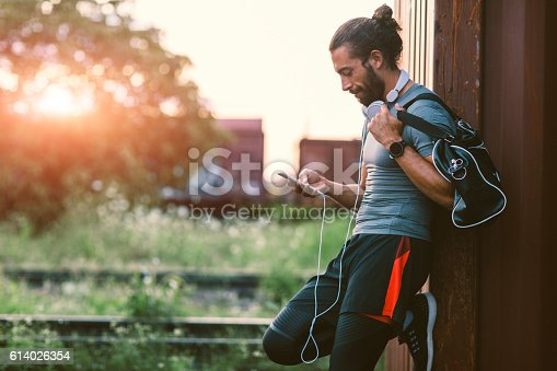 istock Athletic Man Using His Smart Phone. 614026354