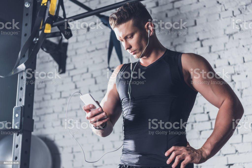 athletic man using smartphone royalty-free stock photo