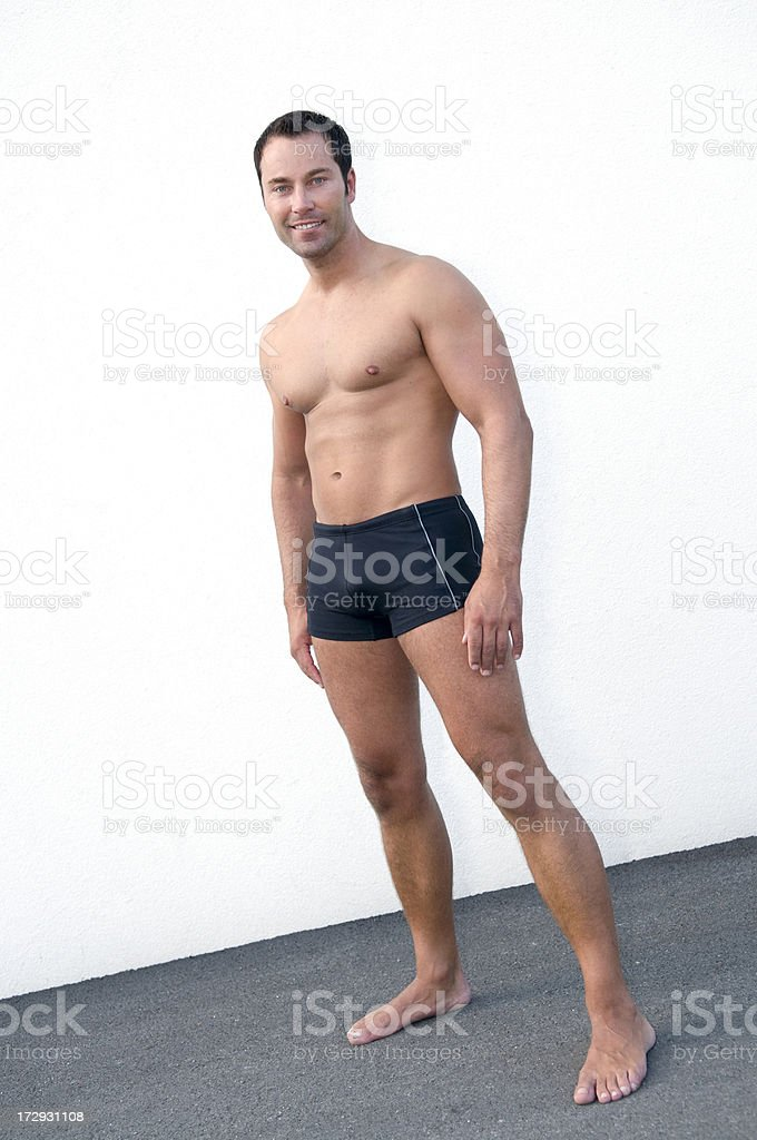 athletic man wearing swimming shorts royalty-free stock photo