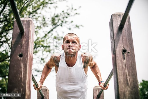 Young, athletic man working out at the park
