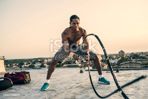 fit young man exercising on the rooftop