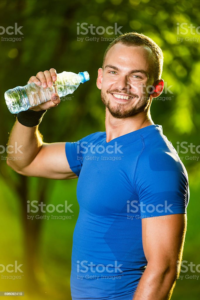 Athletic mature man drinking water from a bottle royalty-free stock photo