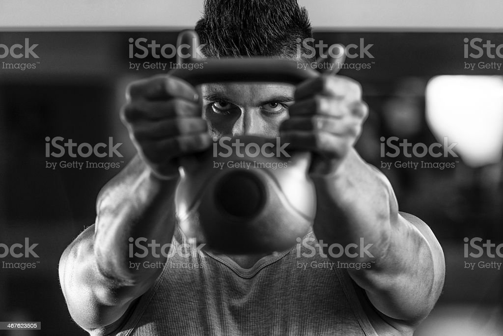Athletic Men Workout With Kettle Bell stock photo