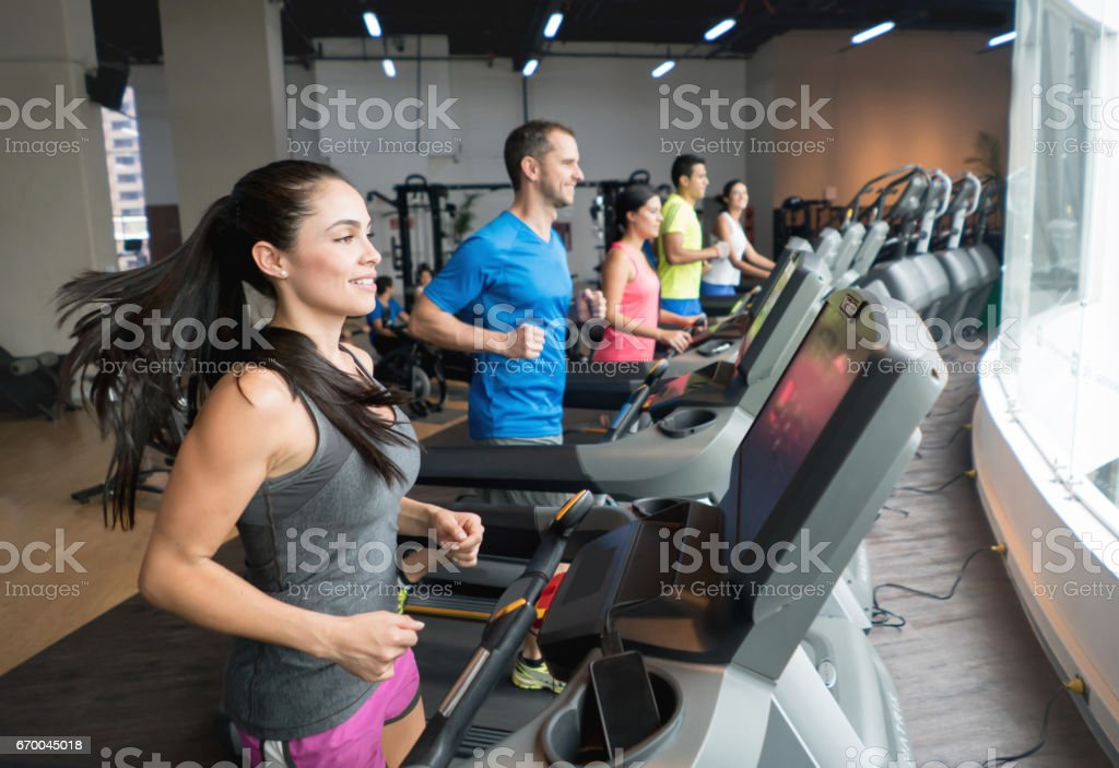Athletic people working out at the gym stock photo