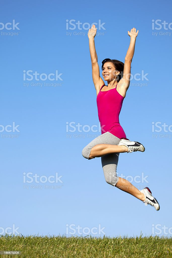 Athletic Runner Celebrates Her Achieved Fitness Goals royalty-free stock photo