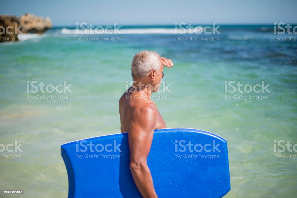 Athletic senior man in the ocean royalty-free stock photo