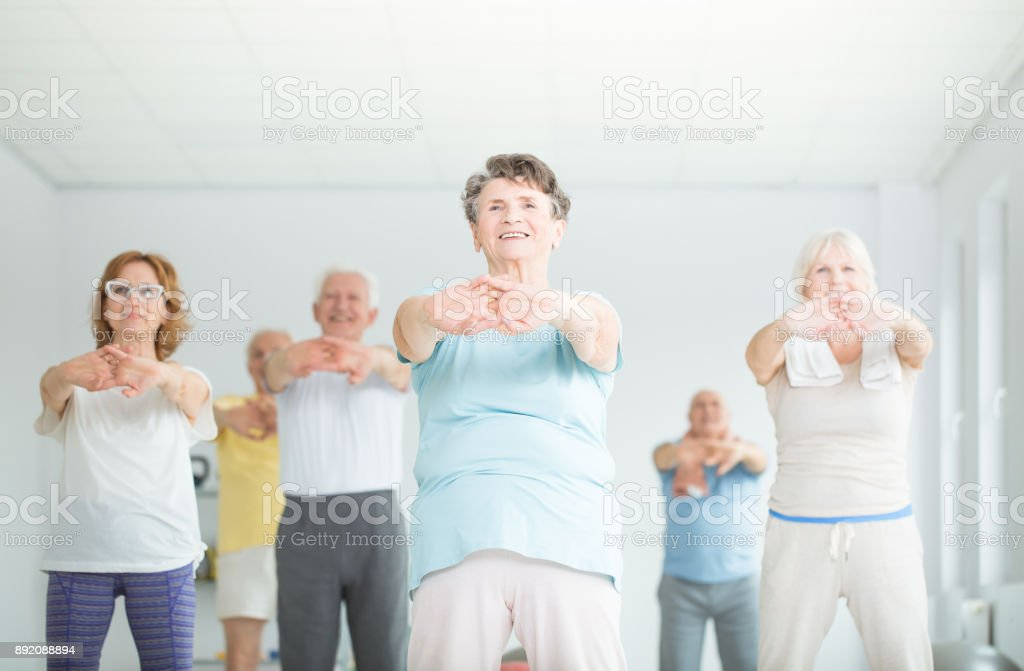 Athletic senior people stretching - Royalty-free Adult Stock Photo