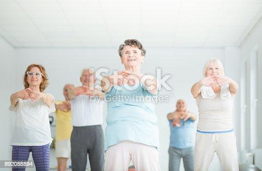 istock Athletic senior people stretching 892088894
