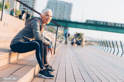 1057638814 istock photo Athletic senior woman resting 1090581862