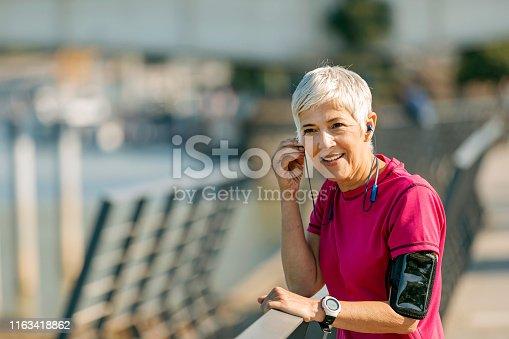 istock Athletic senior woman resting 1163418862