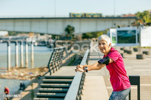 istock Athletic senior woman resting 1163418874