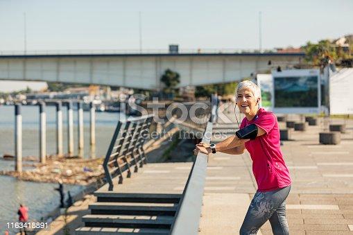 istock Athletic senior woman resting 1163418891