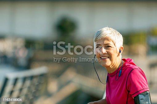 istock Athletic senior woman resting 1163418904