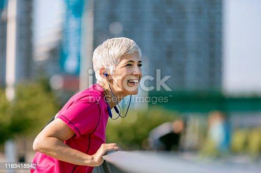 istock Athletic senior woman resting 1163418942