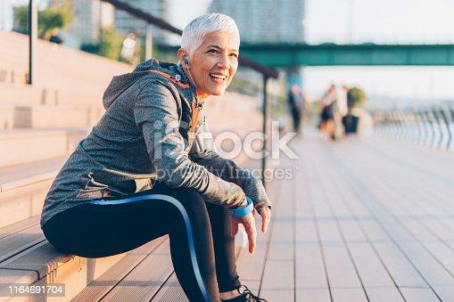 istock Athletic senior woman resting 1164691704