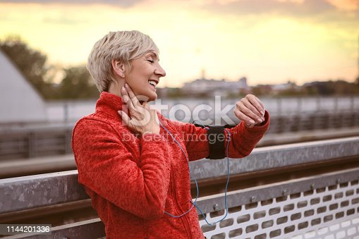 istock Athletic senior woman using smart watch ,checking a pulse pace 1144201336