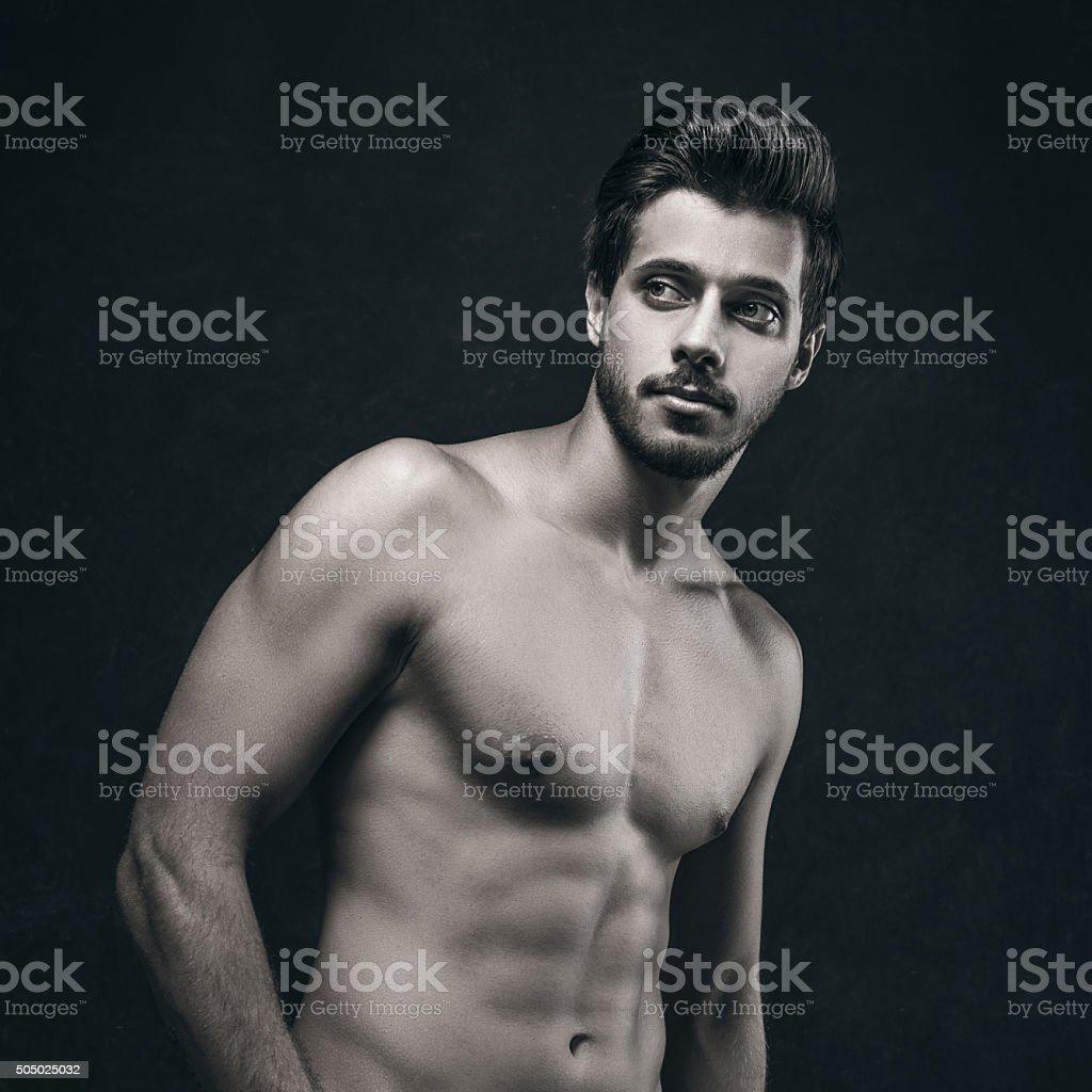 Athletic shirtless man stock photo