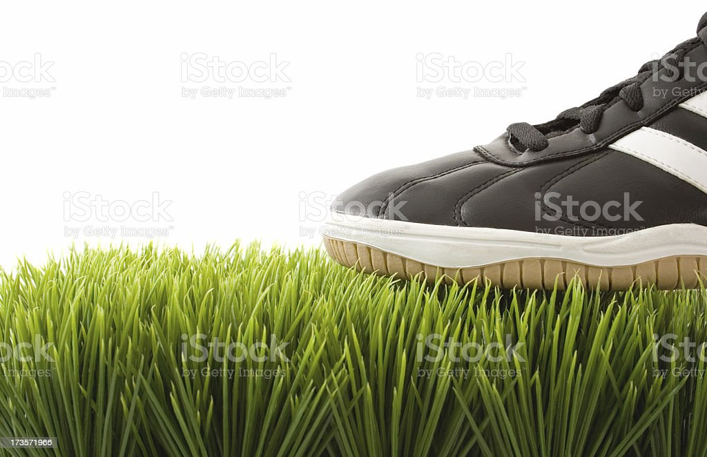 Athletic shoe on Grass stock photo