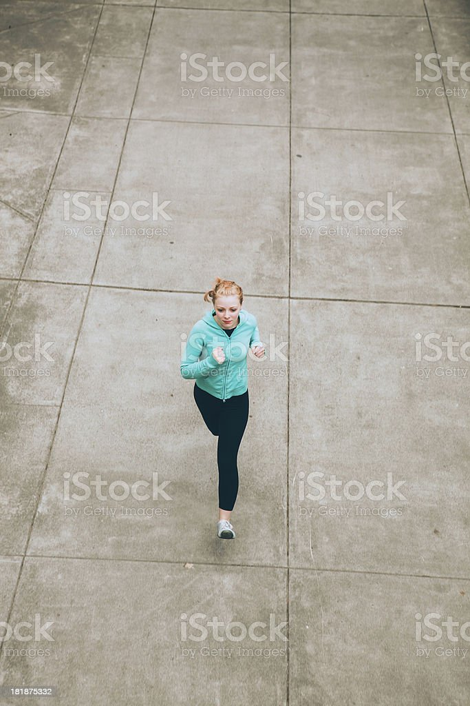 Athletic Woman City Over Head Runner royalty-free stock photo