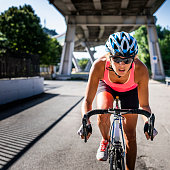Athletic woman cycling road bicycle in the city