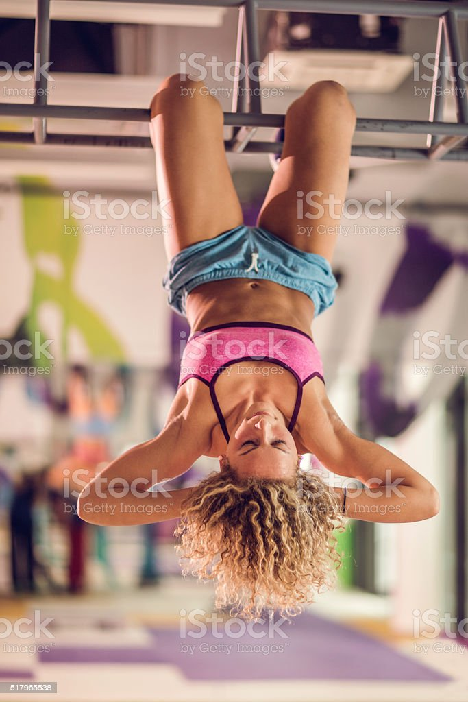 Athletic woman doing gym exercises in a gym. stock photo