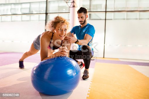 istock Athletic woman having Pilates training with fitness instructor. 539362248