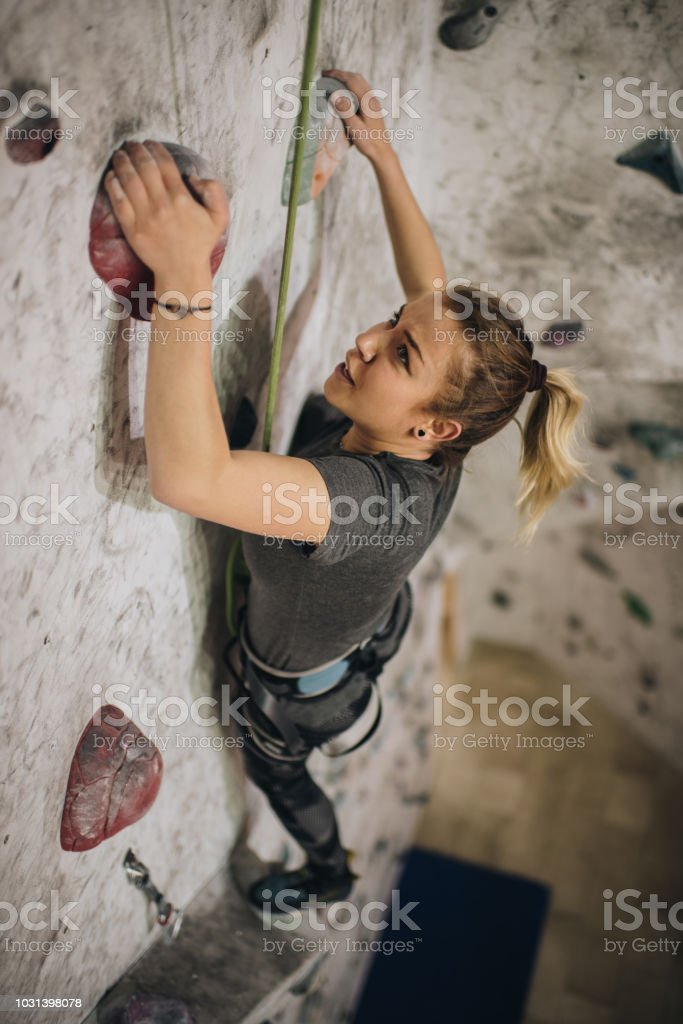 High angle view of young female athlete making an effort while...