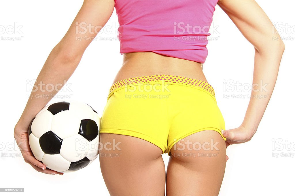 Athletic woman posing with soccer ball on white background royalty-free stock photo