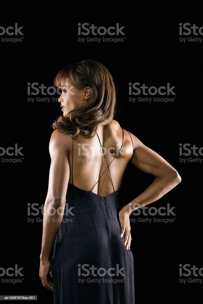 Athletic woman, rear view, studio shot royalty-free stock photo
