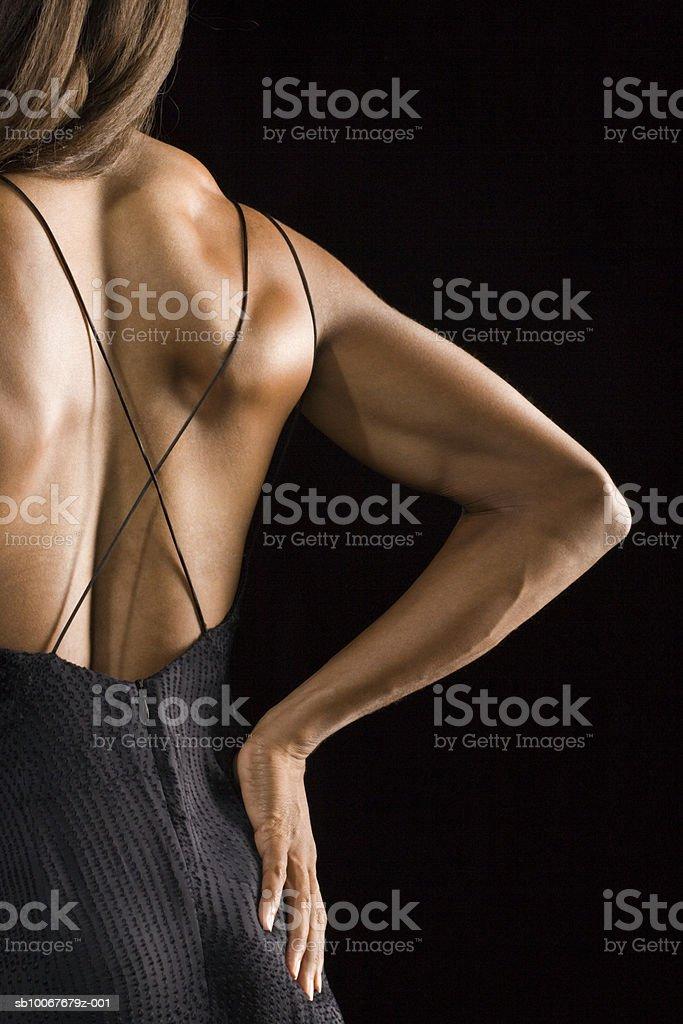 Vue arrière de la femme sportive, prise de vue en studio photo libre de droits