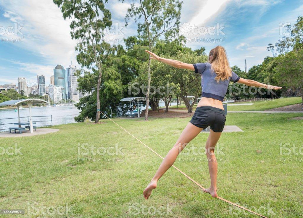 Athletic woman Slacklining, Brisbane, Australia stock photo