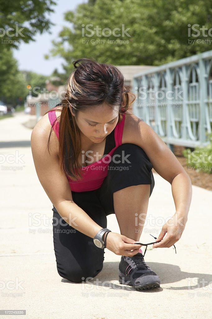 Athletic Woman - Tying Shoes royalty-free stock photo