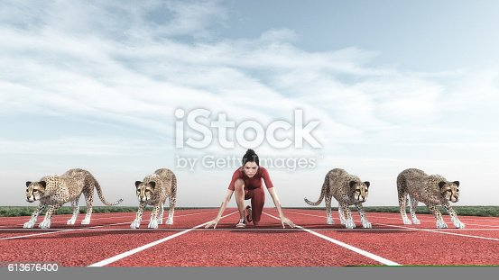 istock Athletic woman with a cheetah on track 613676400