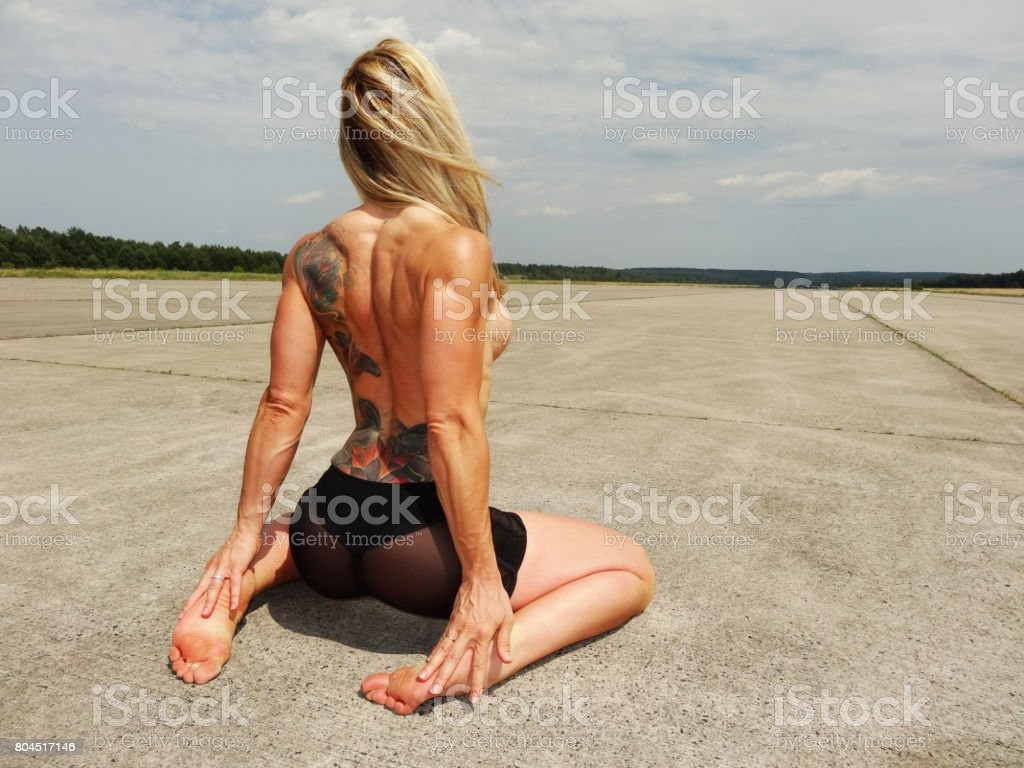 Athletic woman with tattos stock photo
