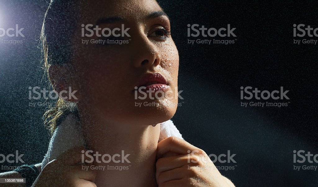 Athletic woman with wet face stock photo