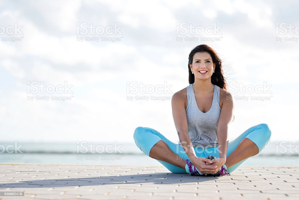 Athletic woman working out outdoors stock photo