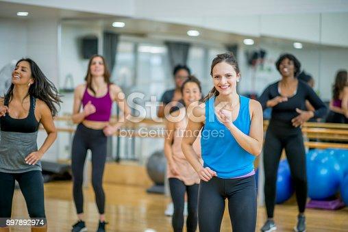 897892972 istock photo Athletic Women Dancing 897892974